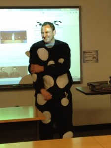 Dr. Michael Seipel sports a cow suit for National Agriculture Week on Friday, March 28. Dr. Seipel's mason jar collected the most money for the Sigma Alpha Penny Wars.