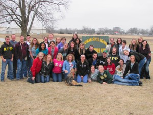Members of Alpha Gamma Rho and Sigma Alpha pose around a National Agriculture Week Sponsor sign, courtesy of AGR at the BBQ on Friday, March 28.