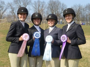 Senior Anna Lotts, juniors Melissa Colby and Christina Iacovino, and senior Megan LaFollette pose for a picture during show weekend. Photo courtesy of Julie Lotts.