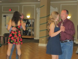Daughters slow dance with their fathers during the Father/Daughter dance on Saturday, April 5.  Right: senior biology major Megan LaFollette.