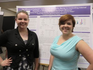 Katie Bruno and Victoria Boston showing findings from research of parasite medicine effectiveness.