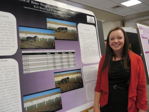 Kylee Short with her poster showing her findings on how weight affects the horses stride length.