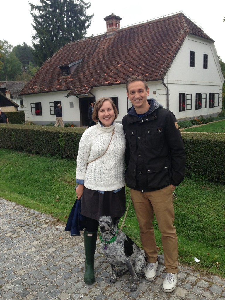 Prof. Heidi Cook, her husband Brent, and Pumpkin, in Kumrovec, Croatia in front of the house where Yugoslavian dictator Josip Broz Tito was born.