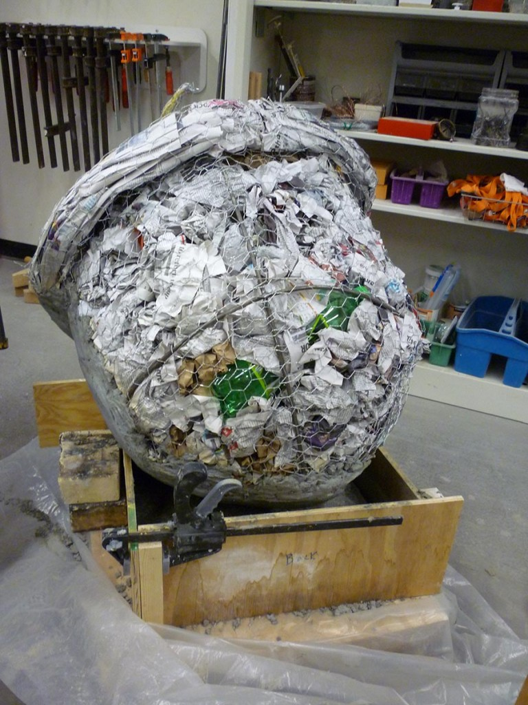 An acorn sculpture in progress, showing the armature and fill before the concrete was added. Even with the lightweight center the sculptures required several people to move each of them.