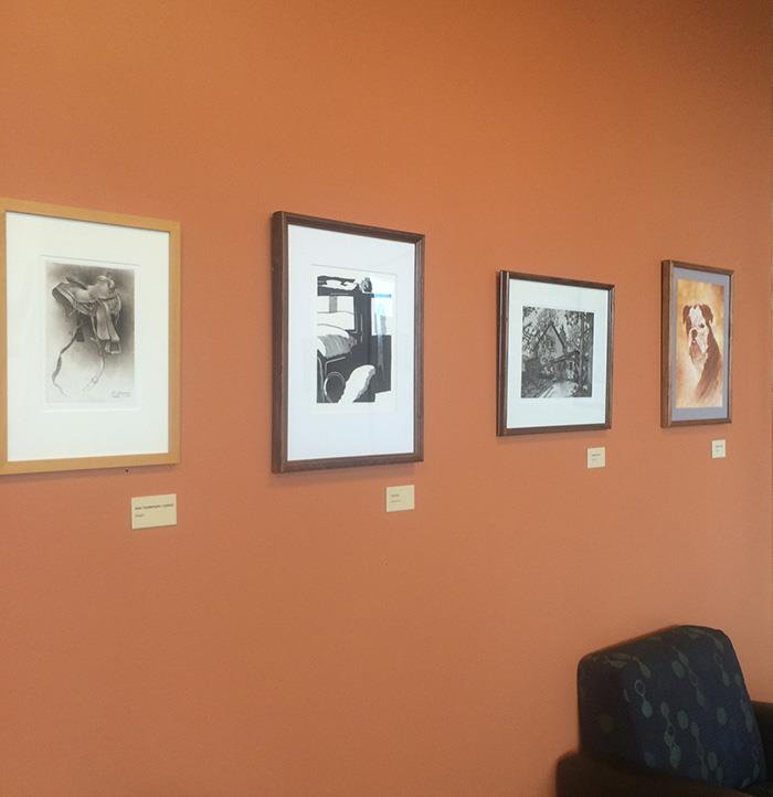 Jim Jereb's prints on display at the coffee shop in Pickler Memorial Library.