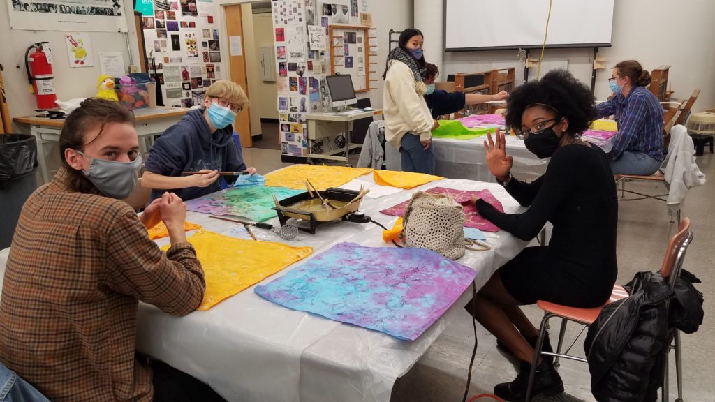 Students work on their batik scarves