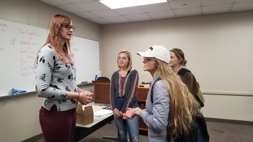 Emily speaking to students in the JUST 402: Victimology class
