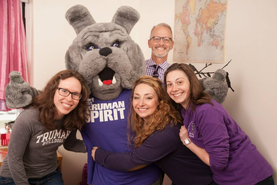 Spike took time to pose for a photo with University President Troy Paino and some Truman students on Spirit Day